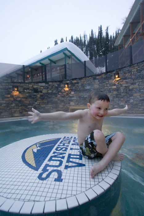 A boy enjoys the oversized hot tub at Sunshine Village. Photo courtesy of Sunshine Village.