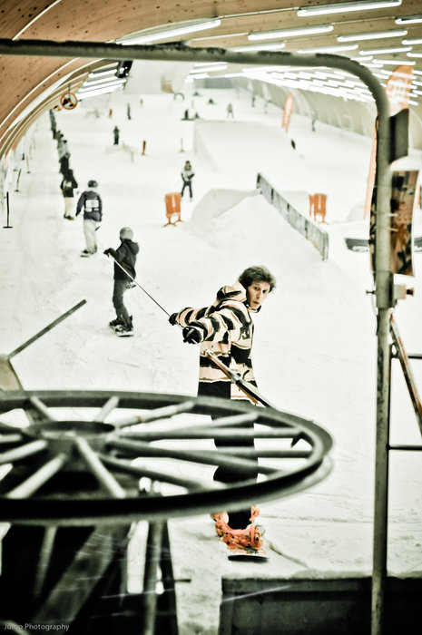 Snowboarders catching a ride on the Ice Mountain, Belgium drag lift.