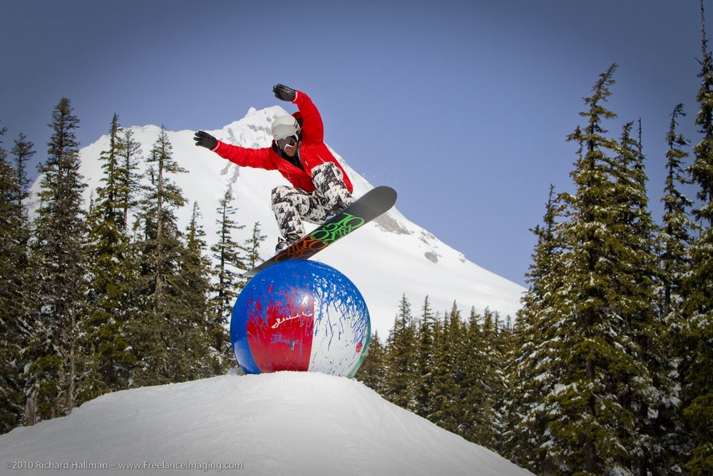 Snowboarder bouncing on beachball at Mount Hood Meadows, Oregon. Image by Richard Hallman.