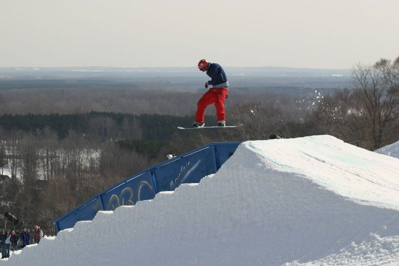 A snowboarder gets air off a jump in the terrain park at Crystal Mountain, Michigan