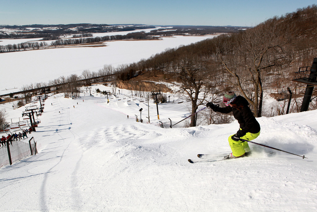 A skier navigates a run at Chestnut Mountain