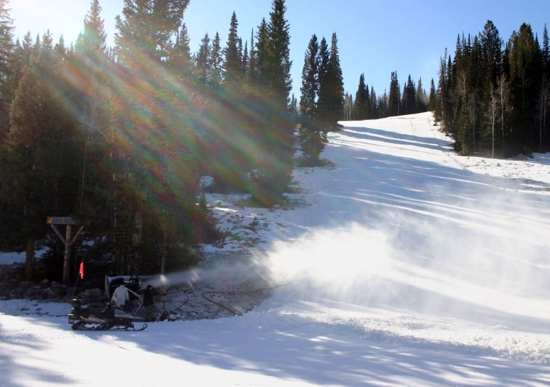 A view of s snowmaking machine and a run at Solitude Mountain Resort, Utah