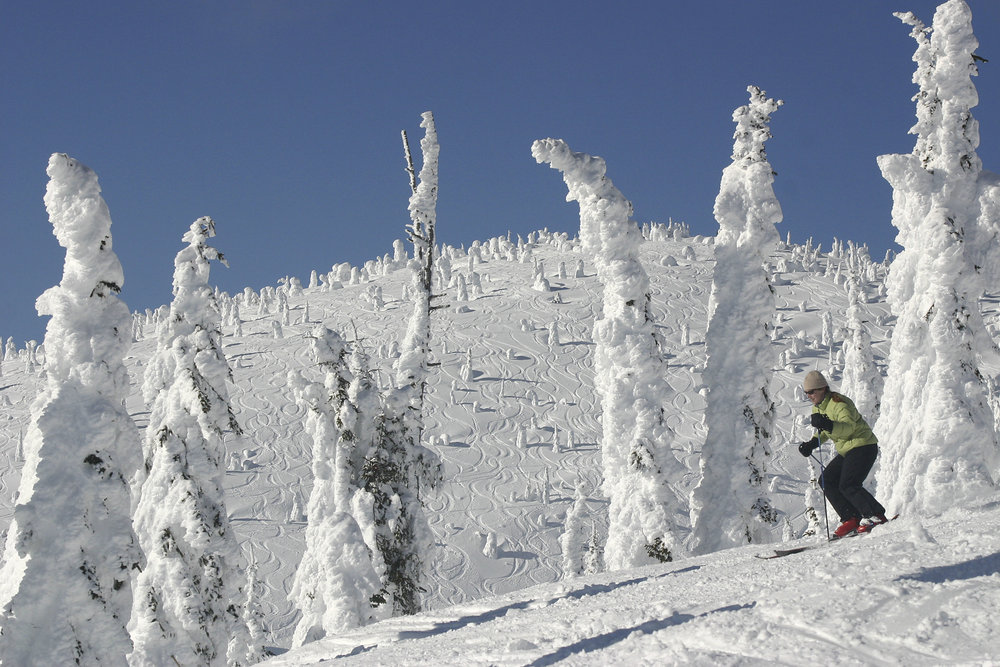 A skier glides by snow ghosts in Hellroaring Basin at Whitefish Mountain Resort, Montana. Photo by Brian Schott, courtesy of Whitefish Mountain Resort.