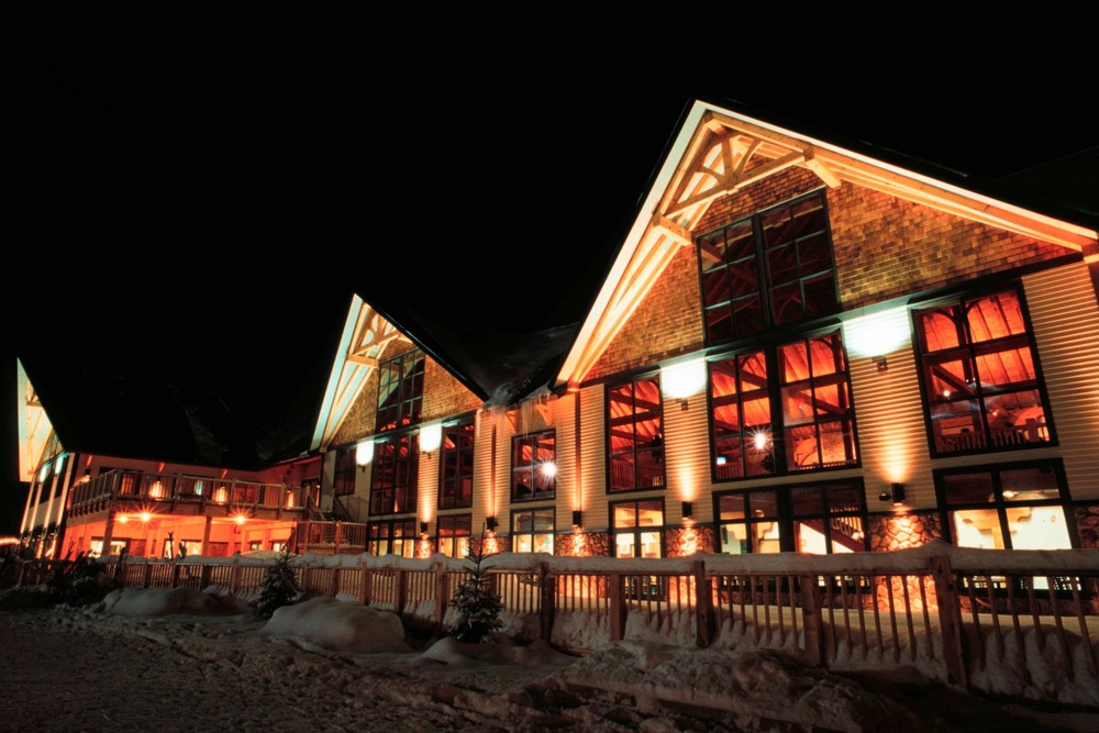 Mount Norquay's Cascade Lodge lights up for night skiing. Photo Courtesy of Banff-Lake Louise Tourism.
