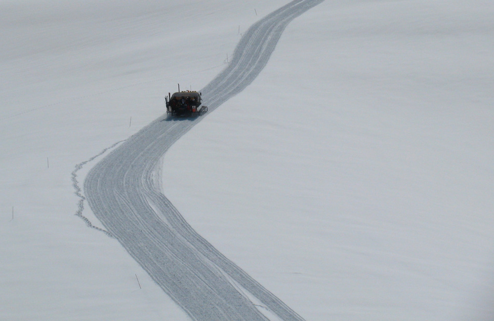 A snowcat climbs the pristine snow slopes of Peaked Mountain at Grand Targhee Resort.  - ©Allison/Flickr