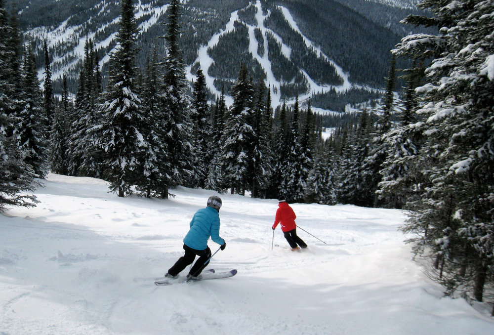 Skiers can try to keep up with Nancy Greene (in red) at Sun Peaks. Photo by Becky Lomax.