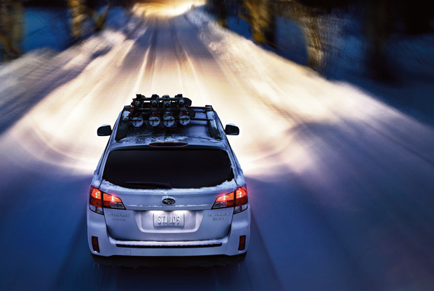 Driving in the nighttime with heavy snow can be tricky. - ©Subaru