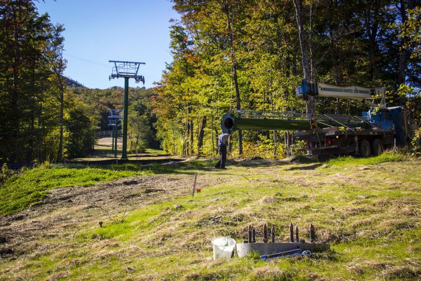 Installing lift towers for the new fixed-grip Taxi Quad. Photo Courtesy of Jay Peak.