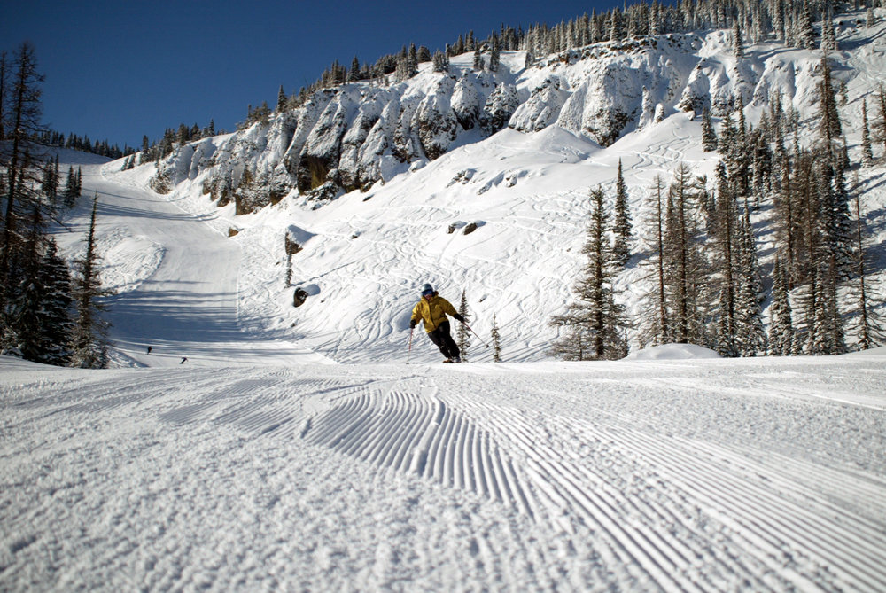 A skier catches corduroy down Mission Ridge's Bomber Bowl.