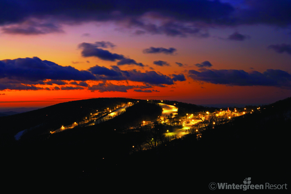 Sunset over lit nightskiing trails at Wintergreen. Photo Courtesy of Wintergreen Resort.