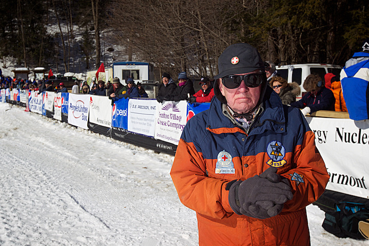 Ski patroller Nick Collins watches the action.
