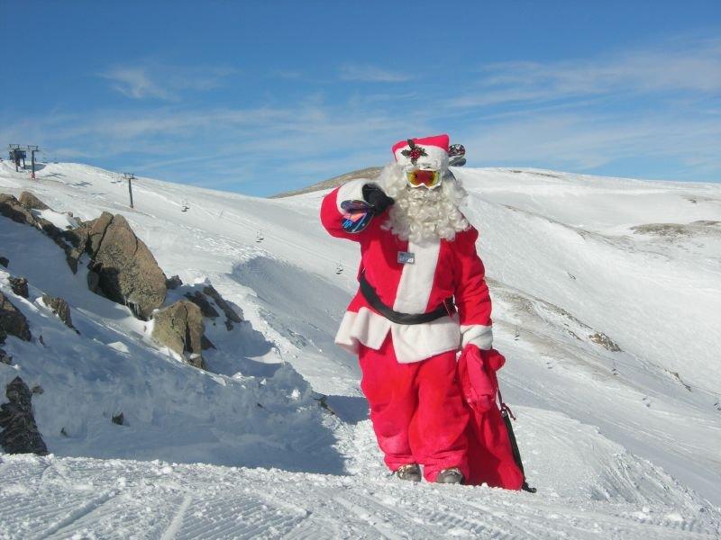 Santa hiking up Loveland.