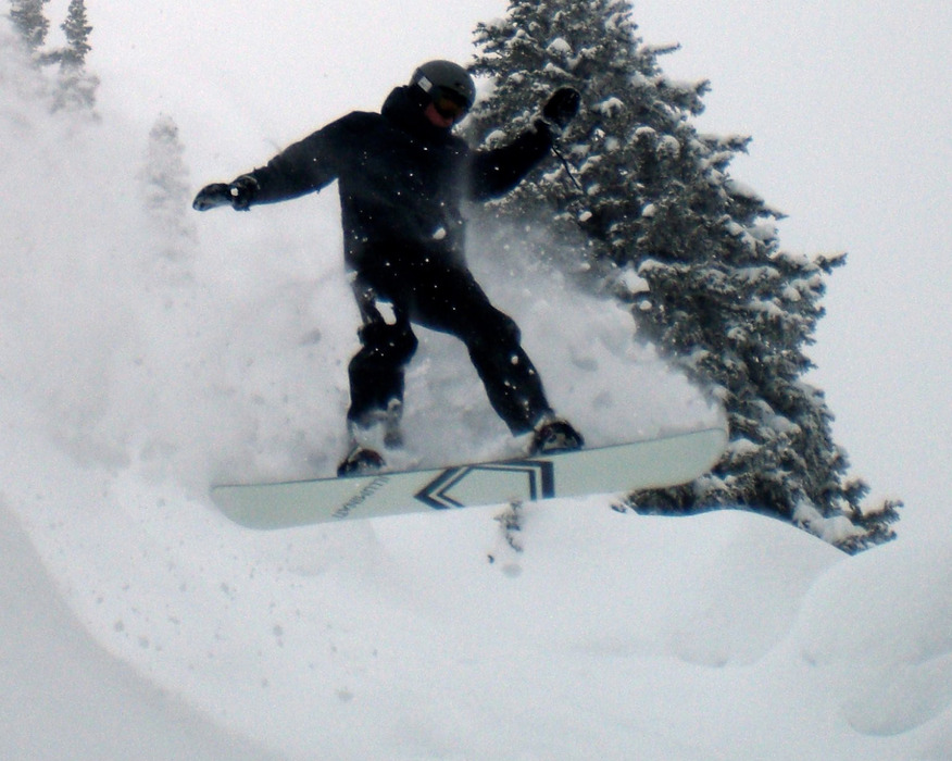 A snowboarder capture air on a Grand Targhee powder day. Photo by Rob Baird/Flickr.