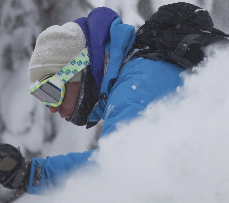 Tom Winter focuses on skiing as much powder as possible Wednesday afternoon.