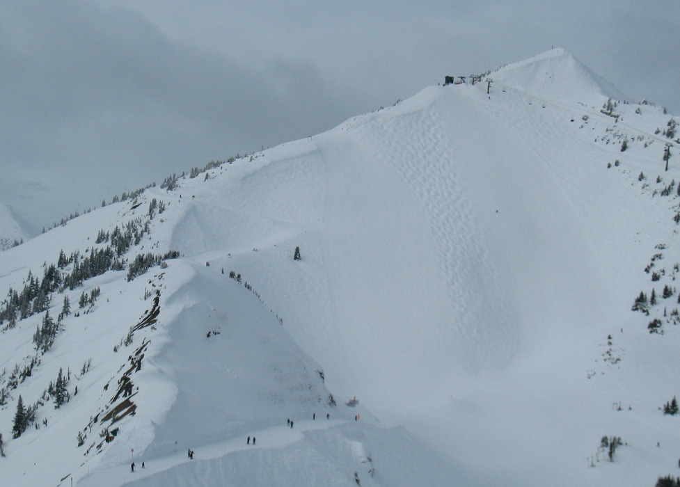 Skiing into Crystal Bowl at Kicking Horse. Photo by Becky Lomax.
