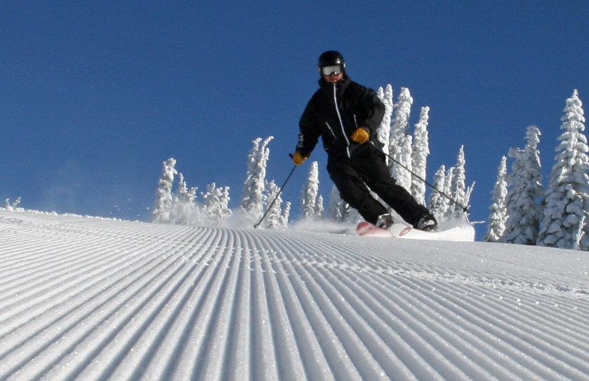 Groomer skiing under blue skies at Brundage. Photo courtesy of Brundage Mountain Resort.