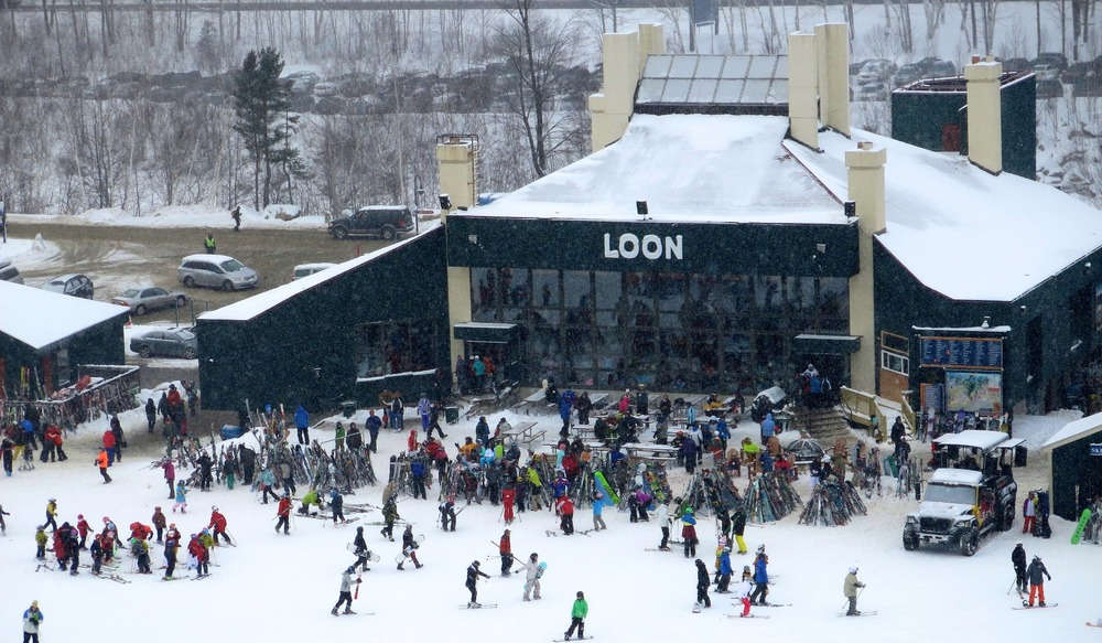 Skiers gather at the base of Kancamagus Lift at Loon Mountain.