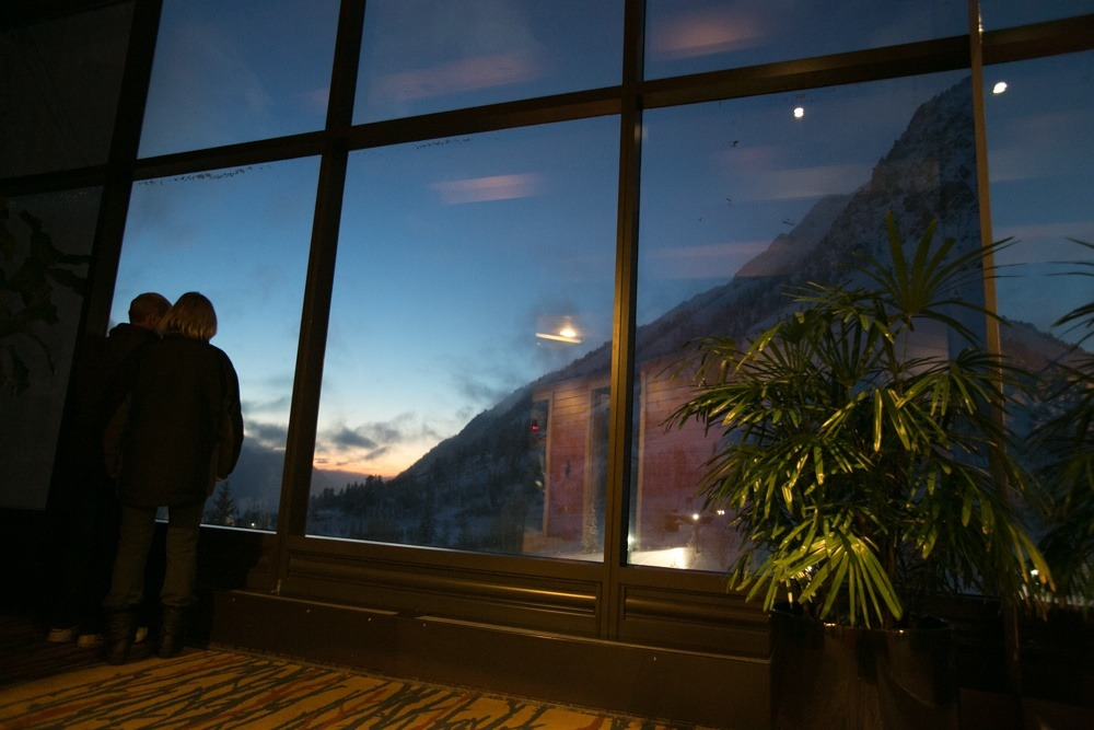 A couple takes in the sunset from the Cliff Lodge at the beast of Snowbird resort.