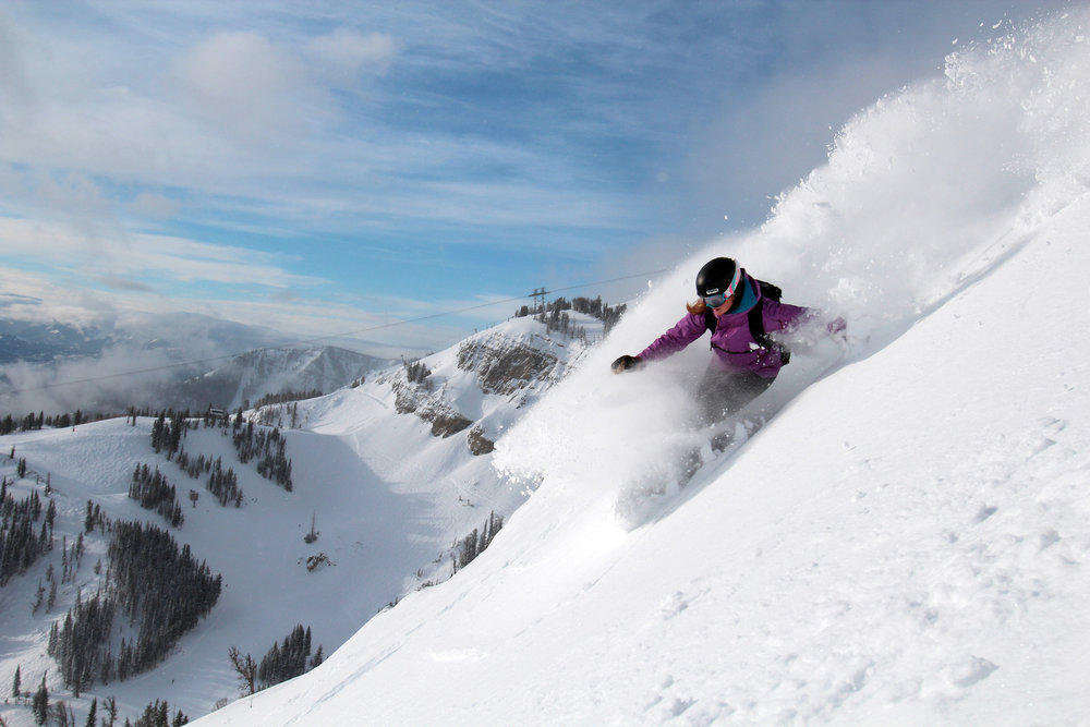 A snowboarder in Jackson Hole powder.