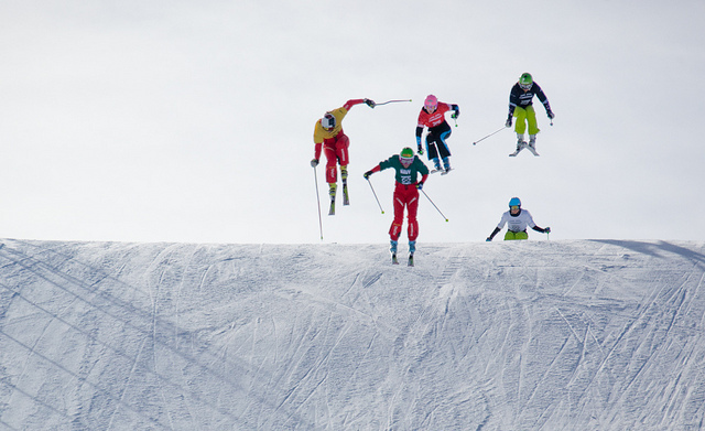 Women competitors fly towards the finish line on the Skier X course.