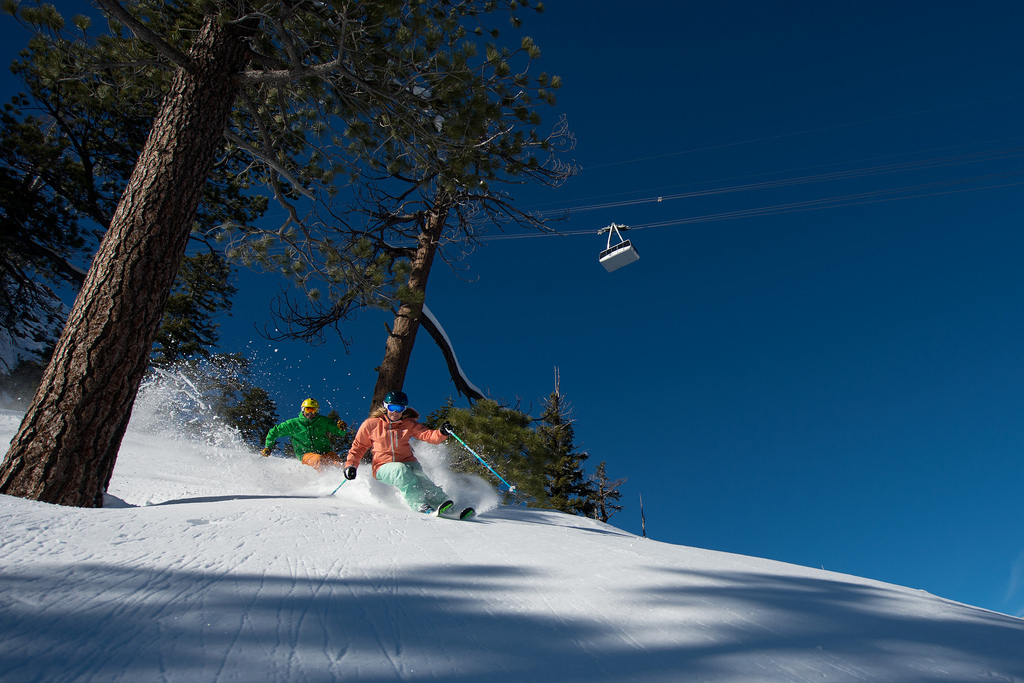 Skiers enjoying some turns beneath the tram at Squaw.