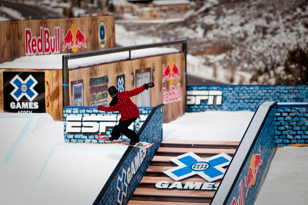 Snowboard slopestyle practice. Riders are judged on creativity, trick completion and style.
