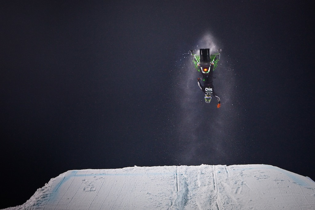 Cory Davis finishing a flip on during Snowmobile Freestyle.