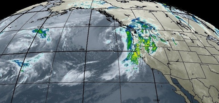 Satellite image of the Pacific Ocean showing multiple storms.