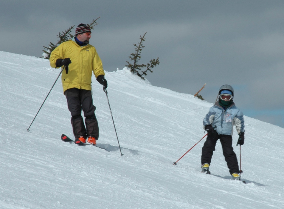 A youngster skis with family at Whitefish Mountain Resort. Photo by Becky Lomax.