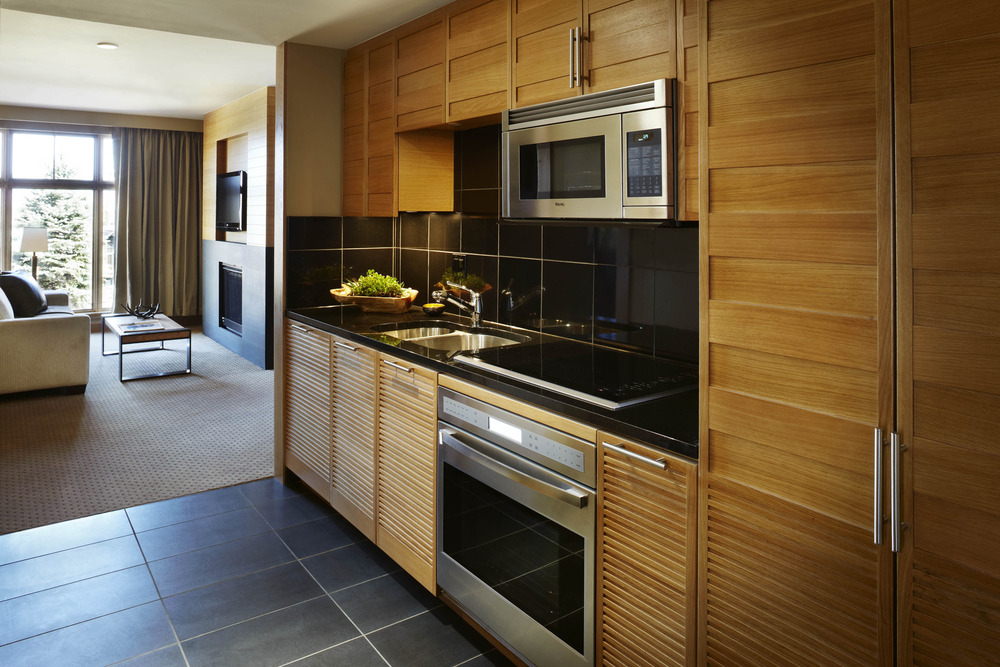 The one-bedroom kitchens are stocked with a Sub Zero fridge, Wolf double burner stove, Viking microwave, Bosch dishwasher, Nespresso coffee maker and foamer, as well as Henckels cutlery.