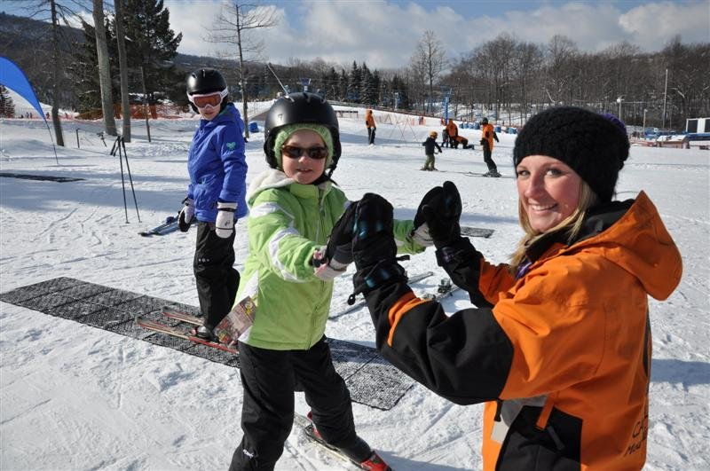 Young skiers getting the feel for sliding on snow.