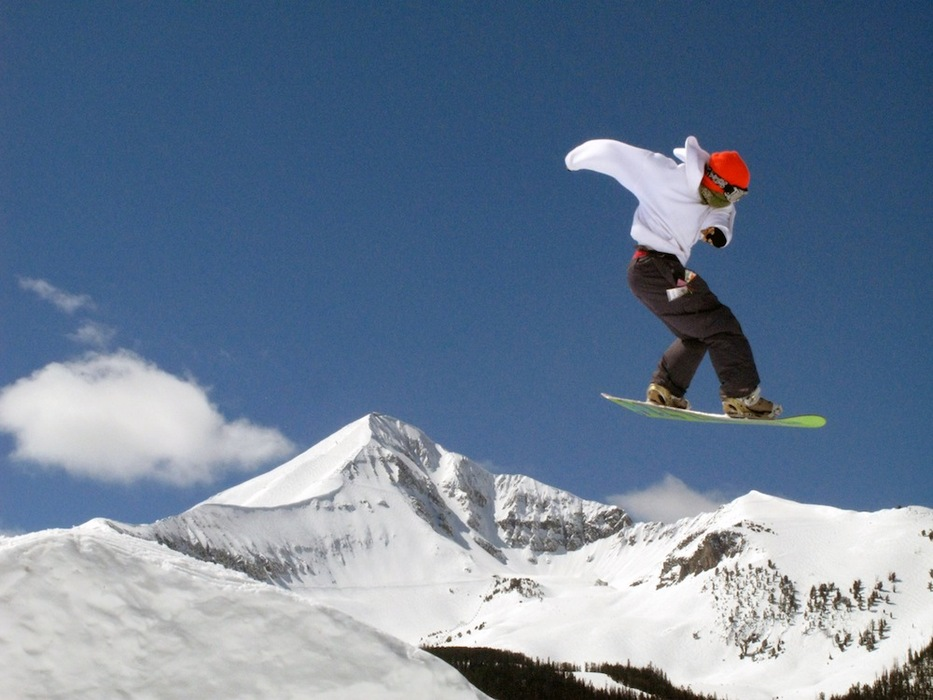 A snowboarder gets air in front of Lone Peak at Big Sky. Photo by Lonnie Ball, courtesy of Big Sky Resort.
