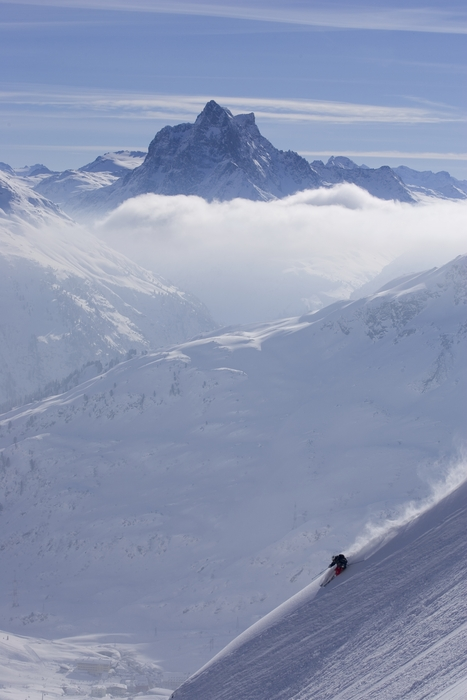 Powder Paradise: Skier on a ridge above St. Anton.