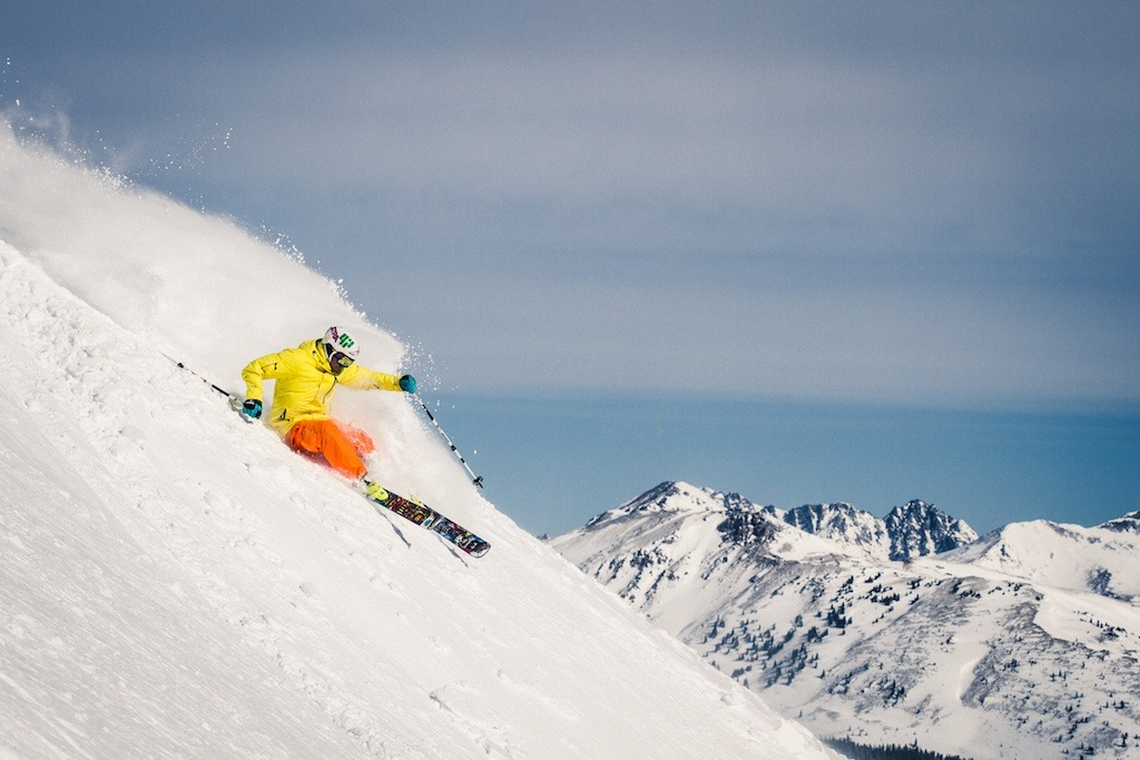 The Gore Range looms in the background as Palmer Hoyt finds another soft turn.