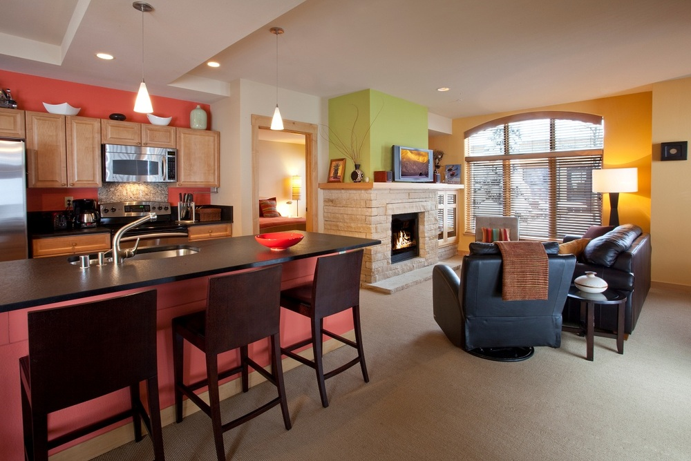 The full kitchen and living room in a 1 bedroom/1 bathroom condo at the Edelweiss Lodge & Spa.
