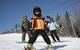 A family enjoys a day of skiing and snowboarding, Spirit Mountain, Minnesota