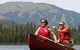 Couple in life jackets canoeing  at Sun Peaks