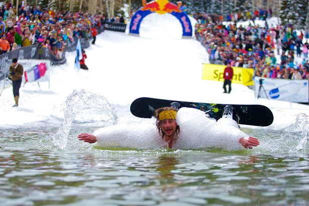 Costumes and fun are mandatory during Canyons Resort's annual pond skimming party. - ©Courtesy of Canyons Resort