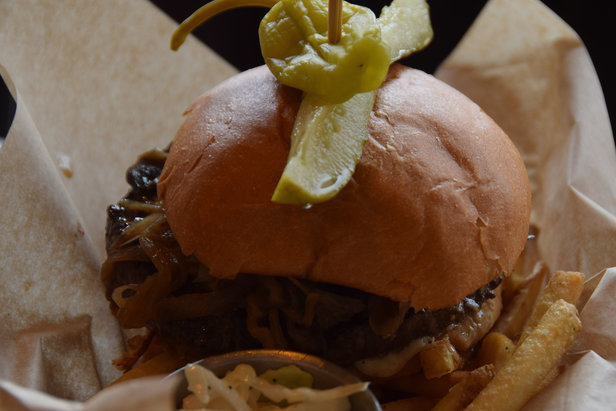 The Handle Bar burger stacks up with caramelized onions and mushrooms. - ©Becky Lomax