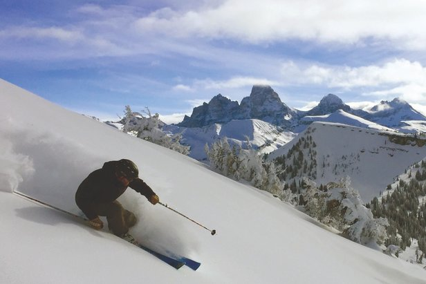 Skiing powder at Grand Targhee with a view of Grand Teton. - ©Court Levy