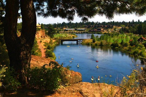 The Deschutes River offers a calm float for all SUP levels of experience. - ©Pete Alport / Visit Bend