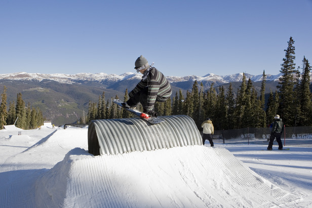 Snowboarder trick in Keystone Colorado