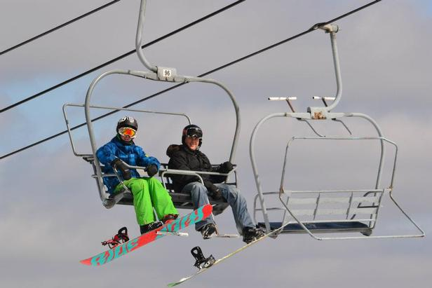 Snowboarders riding the lift at Blue Knob. Photo Courtesy of Blue Knob.