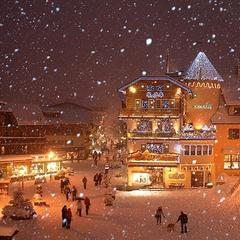 Top family ski resort: Snowy Megeve village at night