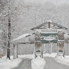 Snowfall at the entrance to Seven Springs Resort in PA. Photo Courtesy of Seven Springs Resort/Facebook