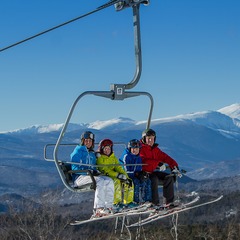 Skiers ride the quad chair at Cranmore. Photo Courtesy of Cranmore Mountain Resort.
