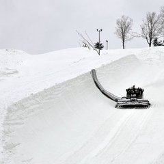 A snowcat equipped with a zaugg cuts the Superpipe wall at Seven Springs. Photo Courtesy of Seven Springs.