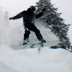 A snowboarder capture air on a Grand Targhee powder day. Photo by Rob Baird/Flickr. - ©Rob Baird/Flickr