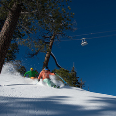 Skiers enjoying some turns beneath the tram at Squaw. - ©Hank deVre and Squaw Valley