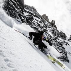 Herb Manning rips a steep line under Palmyra Peak.